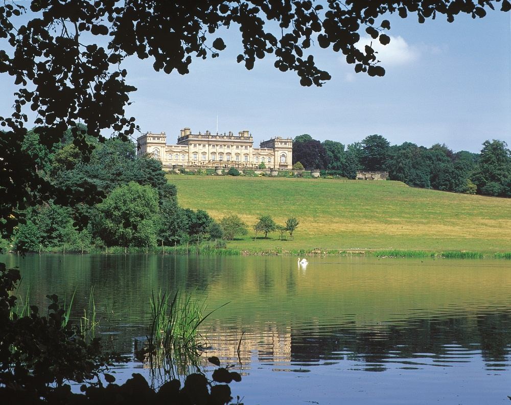 The view of Harewood House from the lake - credit Harewood House Trust
