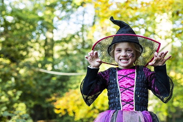 A little girl dressed as a with for Halloween at Lotherton